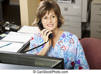 Busy Medical Receptionist - Busy medical receptionist...