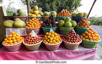tropical fruits in baskets on fruit market, Kintamani, Bali...