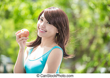 young woman hold red apple