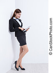 business woman with tablet - business woman lean wall and...