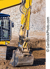 excavator on construction site with earthworks - excavator...