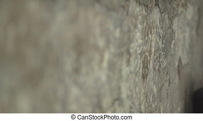 The change of focus that shows the texture of the walls -...