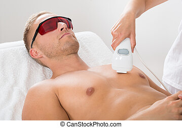 Beautician Giving Laser Epilation On Man's Chest - Female...