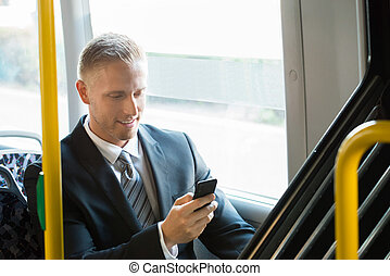 Businessman Using Cellphone - Young Happy Businessman...