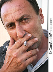 Smoking man, closeup picture