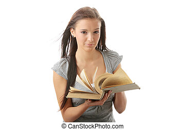 Young teen student woman reading a book