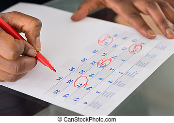 Person Marking Important Date On Calendar - Person Circling...