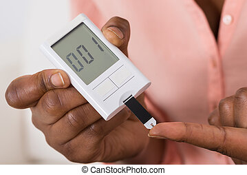 Hand Holding Device For Measuring Blood Sugar