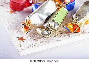Nougats over plate, white background, horizontal image