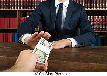 Lawyer Refusing To Take Bribe From Client At Desk -...