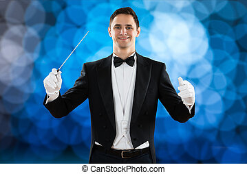Happy Music Conductor Holding Baton - Portrait of happy...