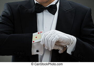 Magician Performing Magic Trick With Cards - Midsection of...