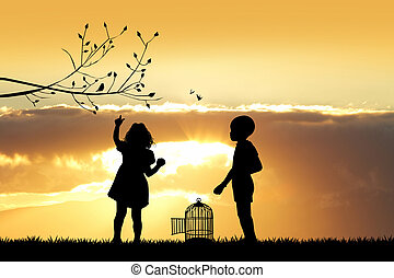children with bird cage at sunset