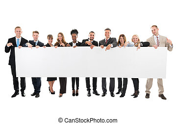 Happy Business Team Pointing At Blank Billboard - Full...