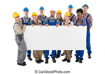 Happy Construction Workers Holding Blank Billboard -...