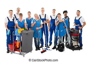 Portrait Of Happy Janitors With Cleaning Equipment -...