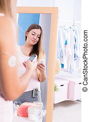 Young woman with glucometer - Image of young ill woman with...