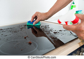 Janitor Cleaning Induction Stove - Cropped image of male...