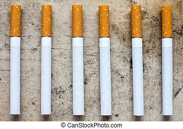 Cigarette addiction - Six cigarettes with filters in a row...