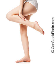 Beautiful wet feet, women legs on white background -...