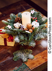 Fir branches decorated for the new year on dark wooden...