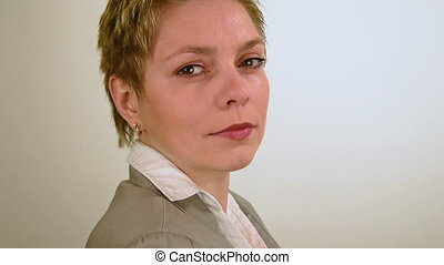 Short hair business woman looks and turns around - Pretty...