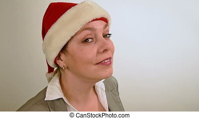 Pretty girl in red Christmas Santa hat smiles - Pretty woman...