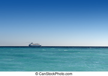 cruise liner on turquoise water - cruise liner sailing away...