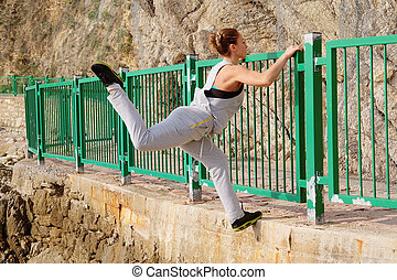 training girl athlete - The image of climbing over a fence...