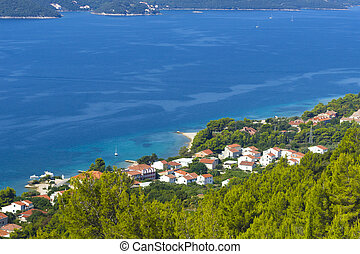 view of the azure sea coast with the town