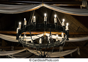 Round iron chandelier - Round iron chandelier in an old...