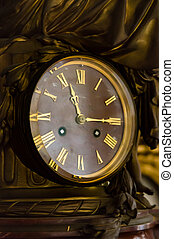 detail of antique table clock with