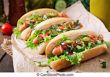 hot dog - Hot dog with jalapeno peppers, tomato, cucumber...