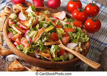 Traditional Arabic fattoush salad close-up on a plate....