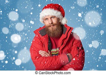 bright picture of handsome man in christmas hat. - Bearded...