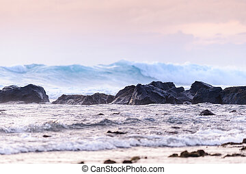 Ocean waves at rocky shore