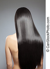 Long straight hair - Back view of a woman with long straight...