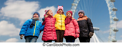 happy little children faces over ferry wheel - childhood,...