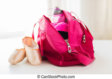 close up of pointe shoes and sports bag - sport, fitness,...