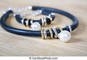 Leather necklace and bracelet with pearl. - Black leather...
