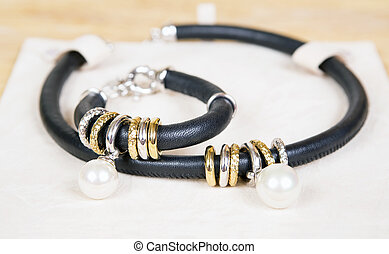 Leather necklace and bracelet with pearl. - Necklace and...