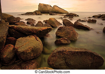 long exposure of rocks at beach
