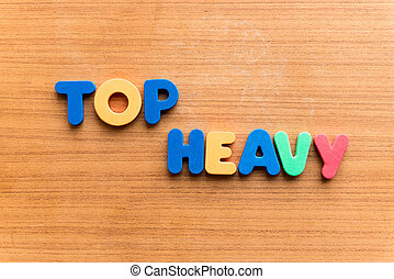 top heavy colorful word on the wooden background