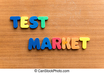test market  colorful word on the wooden background