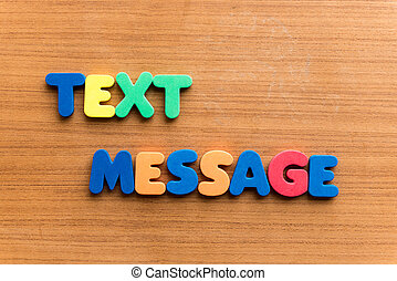 text message  colorful word on the wooden background
