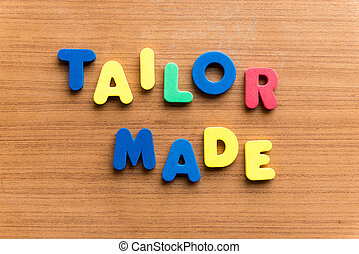 tailor made  colorful word on the wooden background