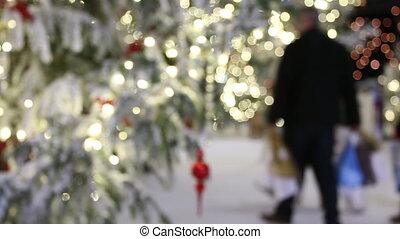 People doing Christmas shopping - Christmas lights and...