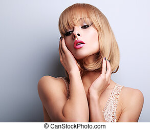 Blond short hair style woman with pink lipstick posing