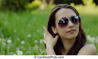 Young Woman in Sunglasses Preens