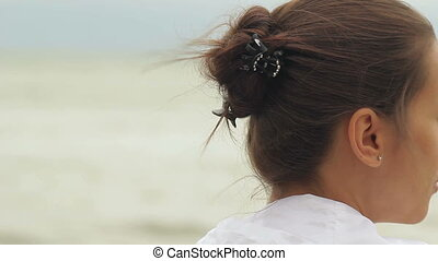Woman at Windy Beach - Woman with pinned hair at windy beach